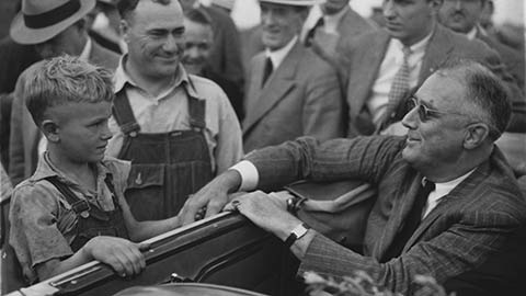 President Franklin D. Roosevelt greets drought-stricken farmers in North Dakota, 1936